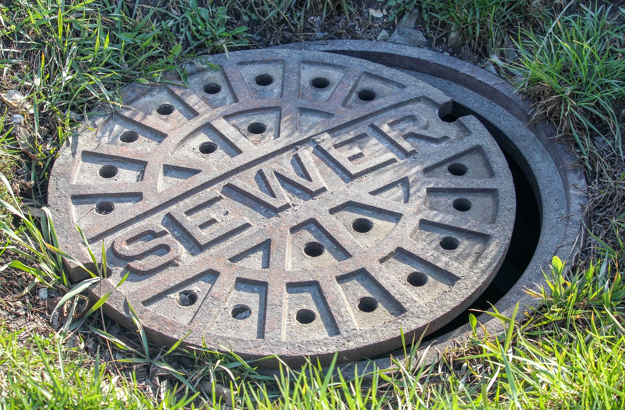 Sewage and Drains Photo by GregReese on Pixabay https://pixabay.com/en/sewer-grass-old-outdoors-round-3305945/